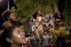 "Women in animal costumes take part in the block party ""Maria vem com as outras,"" or ""Maria, join the other women,"" in Rio de Janeiro, Brazil."