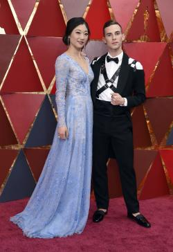 Mirai Nagasu, left, and Adam Rippon arrive at the Oscars.