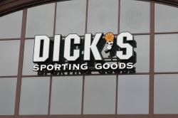 This Thursday, March 1, 2018, file photo shows a Dick's Sporting Goods sign at one of their stores