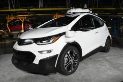 In this Tuesday, June 13, 2017, file photo, a self-driving Chevrolet Bolt EV that is in General Motors Co.'s autonomous vehicle development program appears on display at GM's Orion Assembly in Lake Orion, Mich.