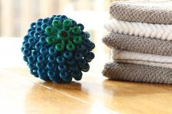 This Dec. 14, 2017 photo provided by Cora Ball shows the Cora Ball, a product developed by a nonprofit group called Rozalia Project that seeks to cut down on small threads that enter waterways when people do laundry