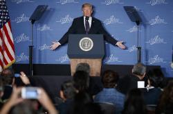 President Donald Trump speaks at the Latino Coalition Legislative Summit, Wednesday, March 7, 2018, in Washington