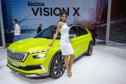 In this March 6, 2018 a hostess poses next to a Skoda Vision X, during a press day at the 88th Geneva International Motor Show in Geneva, Switzerland.
