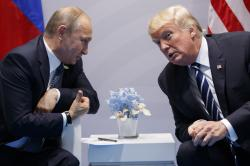 In this file photo taken on Friday, July 7, 2017, U.S. President Donald Trump meets with Russian President Vladimir Putin at the G-20 Summit in Hamburg, Germany