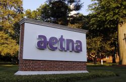 In this June 1, 2017, file photo, a sign stands on the campus of the Aetna headquarters, in Hartford, Conn. Insurers are dropping billions of dollars on acquisitions and expansions as they get more involved in their customers' health