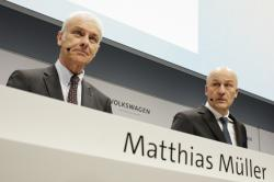 VW group CEO Matthias Mueller, left, and CFO Frank Witter, right, arrive for the annual media conference of the Volkswagen group, in Berlin, Germany, Tuesday, March 13, 2018