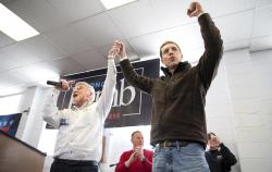 Cecil Roberts, president of the United Mine Workers, left, lifts up Democratic candidate Conor Lamb's hand as the crowd erupts in cheers and chants during a rally, Sunday, March 11, 2018, at the Greene County Fairgrounds in Waynesburg, Pa.