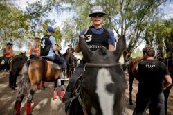 Jon MacLeod, from Seattle, Washington, gets on a polo pony at La Carona club, Capilla del Senor, Buenos Aires province, Argentina.