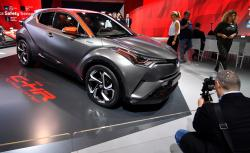 In this Sept. 12, 2017, file photo, a man films a Toyota C-HR concept on the first media day of the International Frankfurt Motor Show IAA in Frankfurt, Germany
