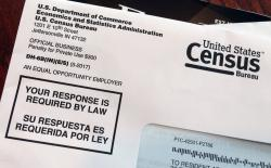This March 23, 2018 photo shows an envelope containing a 2018 census test letter mailed to a resident in Providence, R.I.