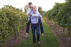 PJ Painter, top, and Ryan Bedinghaus take a fun stroll through the grape vines of Atwood Hill Winery in Atwood, Ky. for an engagement photo.