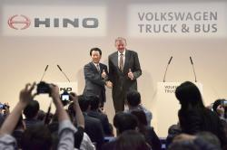 Andreas Renschler, right, a board member at Volkswagen AG and CEO of Volkswagen Truck & Bus, and Hino Motors President and Chief Executive Yoshio Shimo, left, pose for the media during a press conference in Tokyo, Thursday, April 12, 2018