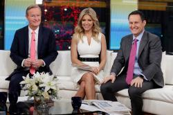 """Fox & Friends"" co-hosts, from left, Steve Doocy, Ainsley Earhardt and Brian Kilmeade appear on their set in New York."