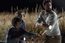 "Noah Jupe, from left, Millicent Simmonds and John Krasinski in a scene from ""A Quiet Place."""