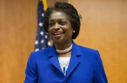 In this Feb. 26, 2015, FCC Commissioner Mignon Clyburn, takes her seat before the start of an FCC open hearing and vote on Net Neutrality in Washington, D.C.