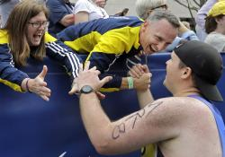 In this April 17, 2017 file photo, Denise, left, and Bill Richard greet a runner who ran in the Boston Marathon for Team MR8, a foundation to honor of their son Martin, killed in the 2013 Boston Marathon bombings