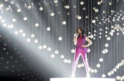 In this May 22, 2015 file photo Austria singer Conchita Wurst, who won the 2014 ESC for Austria, performs on stage during a dress rehearsal for the final of the Eurovision Song Contest in Austria's capital Vienna
