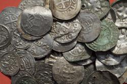 The April 13, 2018 photo shows medieval Saxonian, Ottoman, Danish and Byzantine coins after a medieval silver treasure had been found near Schaprode on the northern German island of Ruegen in the Baltic Sea