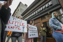 Protesters gather outside of a Starbucks in Philadelphia, Sunday, April 15, 2018.