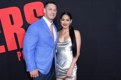 In this Tuesday, April 3, 2018, photo, John Cena, left, and Nikki Bella.