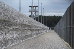 In this Feb. 9, 2016, file photo, razor wire protects a perimeter of the Lee Correctional Institution in Bishopville, S.C.