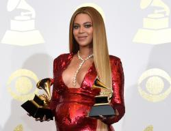 In this Feb. 12, 2017 file photo, Beyonce poses in the press room with the awards for best music video.