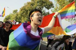 An LGBT group led more than 100 people in joining a large marathon in the city of Nanjing, hold rainbow flags to raise awareness of LGBT issues.