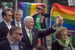 Vice President Mike Pence and his mother Nancy Pence Fritsch, right, wave while walking in the St. Patrick's Day parade Saturday, March 17, 2018, in Savannah, Ga.
