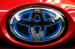 This Feb. 15, 2018, file photo shows the Toyota logo on the trunk of a 2018 Toyota Prius on display at the Pittsburgh Auto Show