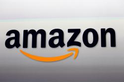 This Sept. 6, 2012, file photo shows the Amazon logo in Santa Monica, Calif. Amazon said Wednesday, April 18, 2018, it has more than 100 million paid Prime members, the first time the company has given out a specific number on its paid subscriber base