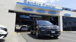 This photo provided by Edmunds shows a 2016 Honda Pilot in the service lanes at Hardin Honda in Anaheim, Calif.