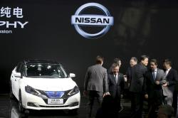 Nissan officials pose for photos with the newly unveiled Sylphy Zero Emission during the start of the Auto China 2018 in Beijing, China, Wednesday, April 25, 2018