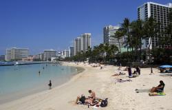 People relax on the beach in Waikiki in Honolulu.