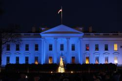 In this April 2, 2017, file photo, the White House is lit with blue lights in honor of World Autism Awareness Day in Washington