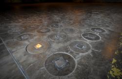 In this Nov., 20, 2013 file photo, after radioactive waste is vitrified and sealed in large stainless steel canisters they are stored under feet of concrete in a glass waste storage building at the Savannah River Site near Aiken, S.C.