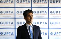 In this Tuesday, May 1, 2018, photo, Suneel Gupta poses at his campaign headquarters in Livonia, Mich.