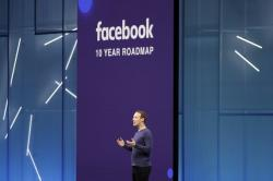 In this May 1, 2018, file photo, Facebook CEO Mark Zuckerberg makes the keynote speech at F8, Facebook's developer conference, in San Jose, Calif.