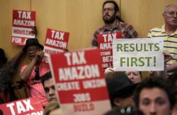 "People fill seats before a Seattle City Council meeting where the council was expected to vote on a ""head tax"" Monday, May 14, 2018, in Seattle"