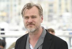 Director Christopher Nolan poses for photographers during a photo call for Rendezvous with Christopher Nolan at the 71st international film festival, Cannes, southern France, Saturday, May 12, 2018