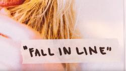 "A still from Christina Aguilera's ""Fall in Line"" lyric video."
