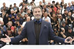 John Travolta poses for photographers during a photo call for the film 'Gotti' at the 71st international film festival, Cannes.