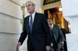 In this June 21, 2017, file photo, former FBI Director Robert Mueller, the special counsel probing Russian interference in the 2016 election, departs Capitol Hill following a closed door meeting in Washington