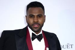 Singer Jason Derulo poses for photographers upon arrival at the amfAR, Cinema Against AIDS, benefit at the Hotel du Cap-Eden-Roc, during the 71st international Cannes film festival.
