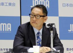 Toyota Motor Corp. chief Akio Toyoda speaks to reporters in Tokyo, Friday, May 18, 2018