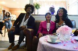 From left, David Alexander Jenkins, Paula Jackson and Cherri Gregg, all of Philadelphia, react during a television viewing party of the royal wedding of Meghan Markle and Prince Harry.