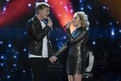 "Caleb Lee Hutchinson, left, and Maddie Poppe perform on the season finale of ""American Idol"" in Los Angeles."