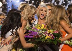 Sarah Rose Summers, Miss Nebraska USA 2018, is crowned Miss USA and congratulated by fellow contestants at the conclusion of the event.
