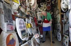 Retired plumber Barney Smith, 96, walks through his Toilet Seat Art Museum in Alamo Heights, Texas.