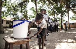 Schoolchildren wash their hands to help contain the Ebola outbreak before entering a classroom in the north-western city of Mbandaka, in Congo.