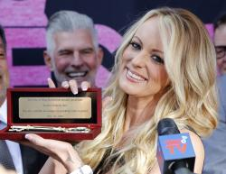 Stormy Daniels shows the Key during a ceremony for her receiving a City Proclamation and Key to the City in West Hollywood, Calif.